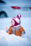 Adorable baby play on winter playground Stock Photography
