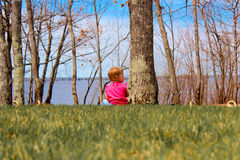 Adorable baby playing. Adorable baby girl playing outside on a sunny day Royalty Free Stock Photo