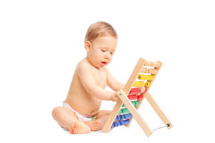 Adorable baby playing with an abacus Royalty Free Stock Photos