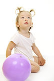 Adorable baby playing with ball. Over white Royalty Free Stock Photo