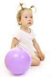 Adorable baby playing with ball. Over white Royalty Free Stock Photography