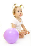 Adorable baby playing with ball. Over white Stock Images