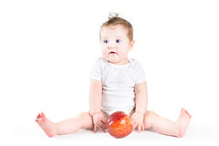 Adorable baby playing with a big red apple Royalty Free Stock Photo