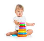 Adorable baby playing with color toy Royalty Free Stock Photos