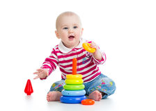Adorable baby playing with color toy Royalty Free Stock Photo