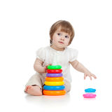 Adorable baby playing with colour toy Stock Images