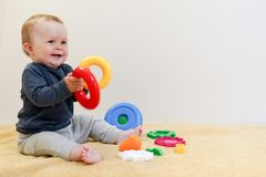 Adorable baby playing with educational toys . background with copy space. Happy healthy child having fun at home. Early royalty free stock images