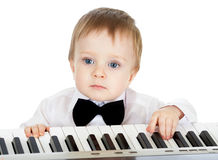 Adorable baby playing electronic piano Royalty Free Stock Photos