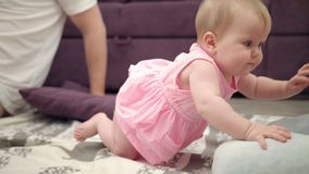 Adorable baby playing with father. Infant crawling to mom. Toddler girl crawl stock footage