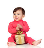 Adorable baby playing with a present Stock Photography