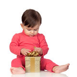Adorable baby playing with a present Royalty Free Stock Image