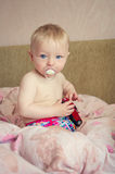Adorable baby playing with a toy car Royalty Free Stock Photos