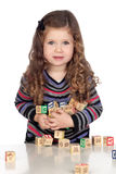 Adorable baby playing with wooden blocks Stock Photos