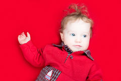 Adorable baby on a red blanket Stock Photo