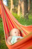 Adorable baby relaxing in hammock Stock Image