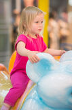 Adorable baby ride on carousel in mall Royalty Free Stock Photography