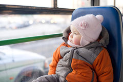 Adorable baby riding in city bus Stock Photos