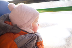 Adorable baby riding in city bus Stock Photography