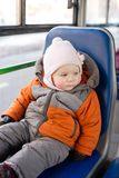 Adorable baby riding in city bus on seat place Royalty Free Stock Photos