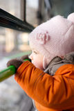 Adorable baby riding in city bus on seat place Stock Images