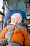 Adorable baby riding in city bus sitting Royalty Free Stock Image