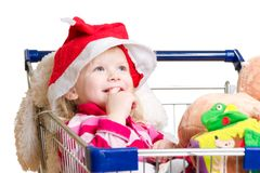 Adorable baby in santa hat with toys Stock Photo