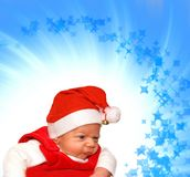 Adorable baby in Santa suit. On abstract background Royalty Free Stock Photos