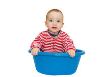 Adorable baby sit in a blue basin Stock Image