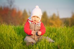Adorable baby sit near top of hill Royalty Free Stock Photography