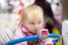 Adorable baby sit on shopping cart in store Royalty Free Stock Images
