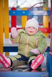 Adorable baby sit on slide on playground. Adorable baby sit on slide Royalty Free Stock Image
