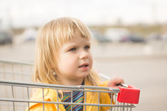 Adorable baby sit in supermarket cart Royalty Free Stock Photography