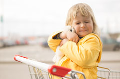 Adorable baby sit in supermarket cart Stock Photos