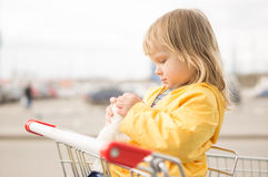 Adorable baby sit in supermarket cart Royalty Free Stock Photo