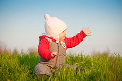 Adorable baby sit on top of hill Stock Images