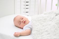 Adorable baby sleeping in cradle. At home Stock Photography