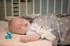 Adorable baby sleeping in cradle. At home Stock Photo