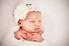 Adorable baby sleeping in hair band with flower Royalty Free Stock Photo