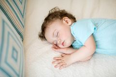 Adorable baby sleeping and having sweet dreams royalty free stock image
