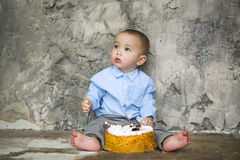 Adorable baby smashing cake Royalty Free Stock Photo