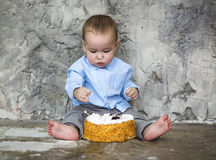 Adorable baby smashing cake Stock Photo