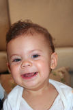 An adorable baby smiling Royalty Free Stock Photos