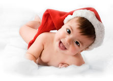 Adorable baby smiling with christmas hat. On white background Stock Image