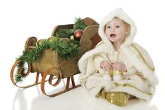 Happy Snow Princess with Her Sleigh stock photos