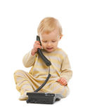 Adorable baby speaking on phone on white stock image
