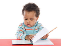 Adorable baby studying Royalty Free Stock Photos
