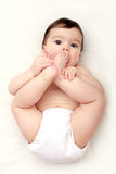 Adorable baby sucking his toes Royalty Free Stock Photos