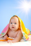 Adorable baby with sun and sky Stock Photo