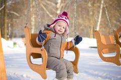 Adorable baby swing Stock Photo