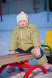 Adorable baby swing on playground Stock Photography